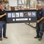 Frank & Henry display framed catalog covers from the last 10 years.